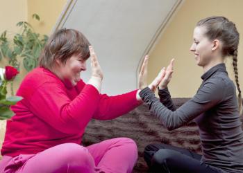 Two women doing rhythm exercises