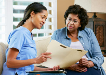 elderly woman and a nurse discussing