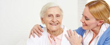 portrait of a caregiver and senior woman